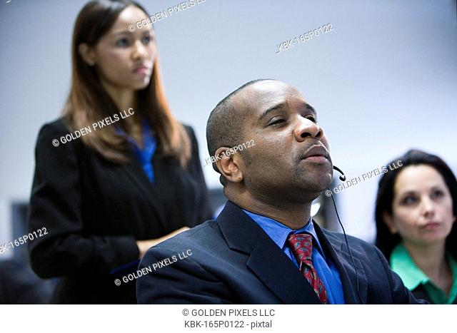 Business man and women watching and listening attentively