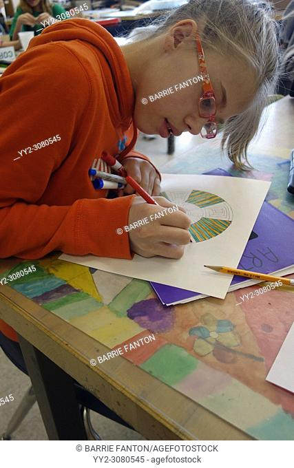 6th Grade Girl Working on Design in Art Class, Wellsville, New York, USA