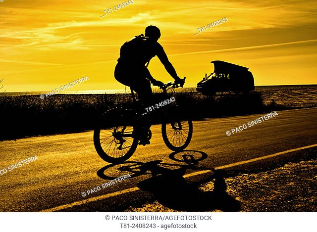 cyclist and motor home at dawn in Alcocebre, Spain