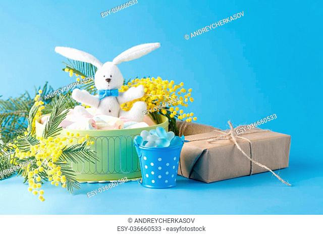 Sweets present in box with white rabbit and spring flowers