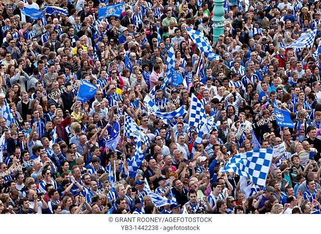 Brighton and Hove Albion Football Supporters cheer the team during the clubs victory parade along Brighton seafront to celebrate winning the league one title...