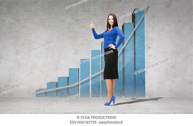 business, financial, statistics and office concept - smiling confident businesswoman showing thumbs up