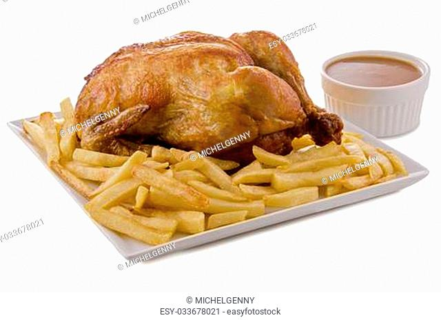 Roasted chicken, french fries and barbecue sauce isolated on white background. Close up