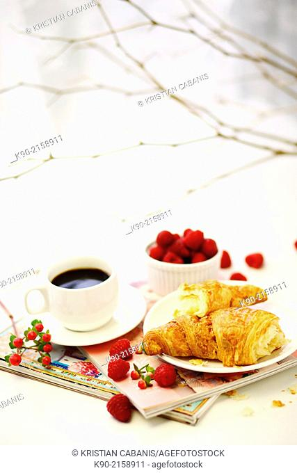 Breakfast Arrangement with Croissant, coffee and red raspberries in a cup with white background, Hong Kong, China, Asia