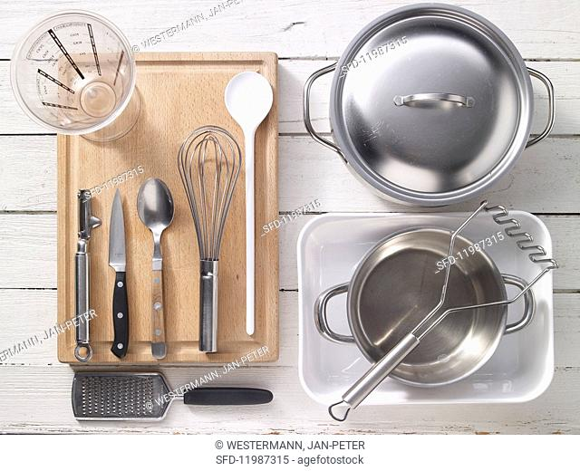 Kitchen utensils for fish bake with crushed potatoes