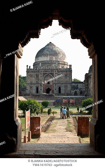 Bara Gumbad mosque viewd through the arch of Sheesh Gumbad, Lodi Gardens, New Delhi, India