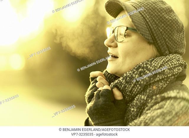 woman breathing in park, Munich, Germany