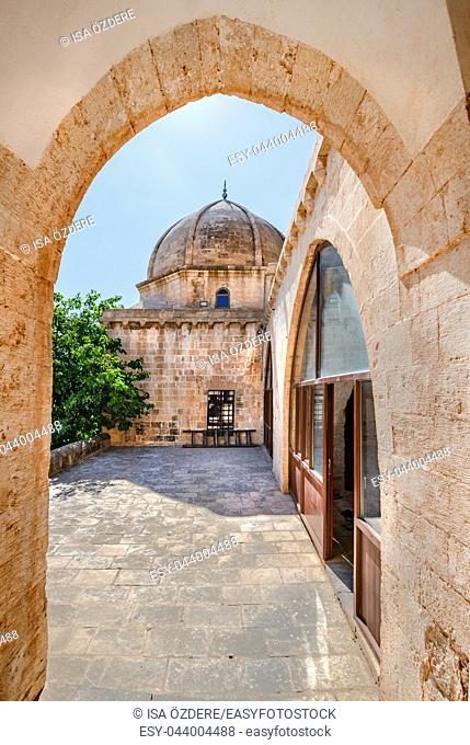 Gate and courtyard of Hamidiye Mosque(Seyh Zebuni)built in 1347 and locates in Mardin, Turkey. 17 June 2018