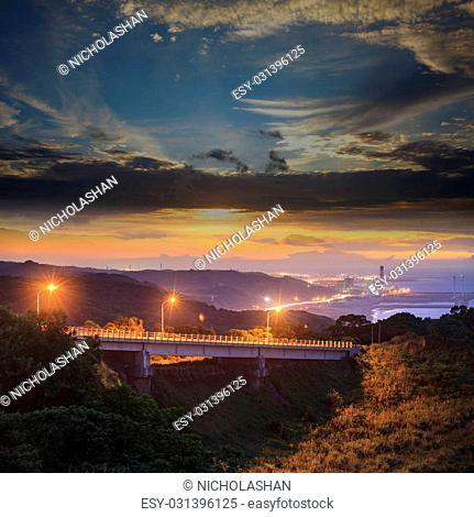 The beautiful sunset with a bridge over sea
