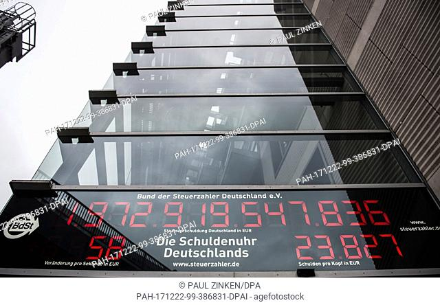 The public debt clock of the German Taxpayers' Association counts debt in Berlin, Germany, 22 December 2017. Media reports have stated that at the start of 2018