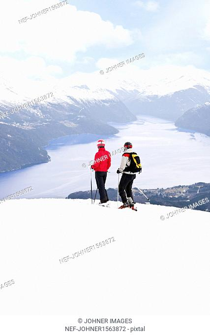 Mid adult couple skiing