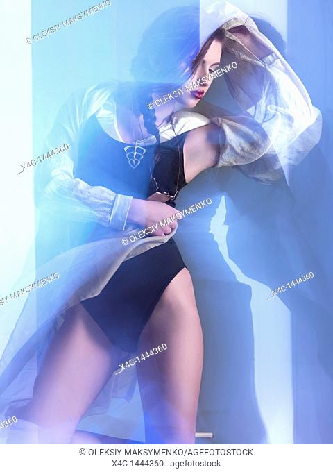 Futuristic dynamic high fashion photo of a young woman in trendy clothes posing in shiny neon light settings  The photo was not digitally manipulated