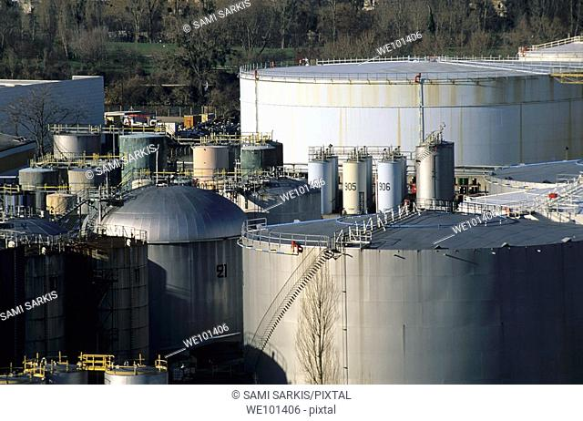 Cluster of industrial oil tanks next to a residential area, Paris, France