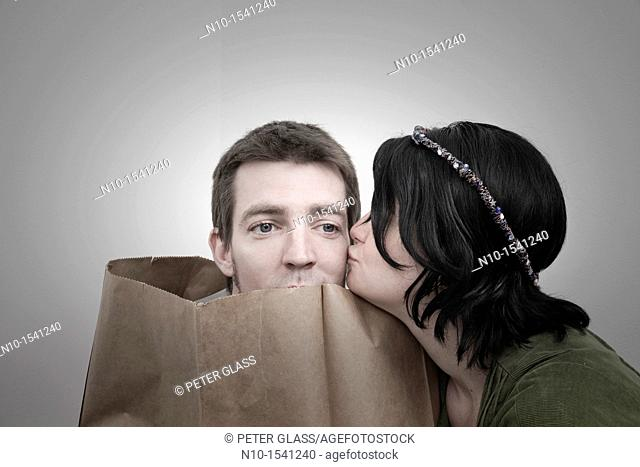 Woman with her husband, who is in a paper bag