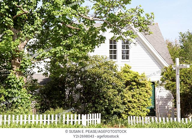 An old home peaks out from behind spring foliage in West Tisbury, Martha's Vineyard, Massachusetts, United States, North America. Editorial use only