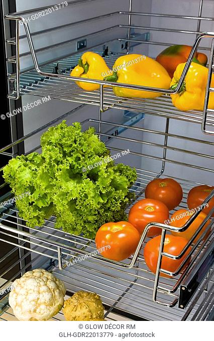 Vegetables on shelves in the kitchen