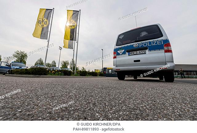 Police cars park outside the training grounds in Dortmund, Germany, 12 April 2017. Three explosions occurred next to the team bus of the Borussia Dortmund...