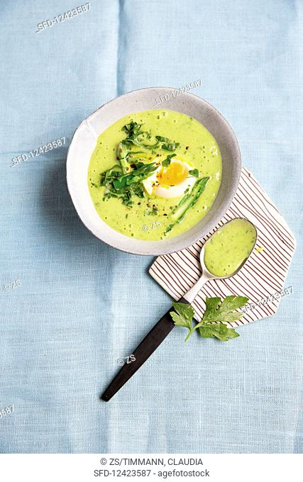 Cream of herb and asparagus soup with soft-boiled eggs