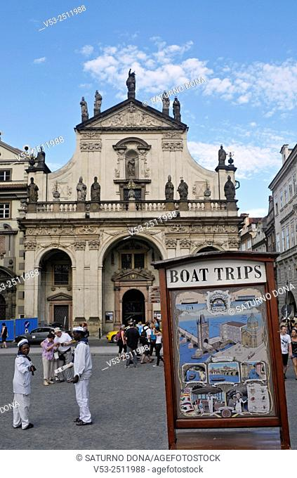 Boat trips sign and St. Salvator Church, Krizovnicke namesti square in Prague, Czech Republic
