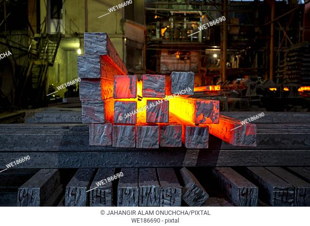 Heated metal pig gets squeezed and drilled at special metal forging unit at Brueck metal forging factory in Demra, Dhaka, Bangladesh