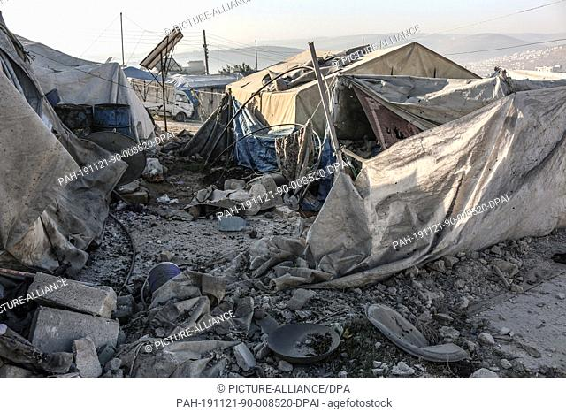 21 November 2019, Syria, Qah: A general view of damaged tents after a rocket attack that was allegedly carried out by the Syrian government forces the night...