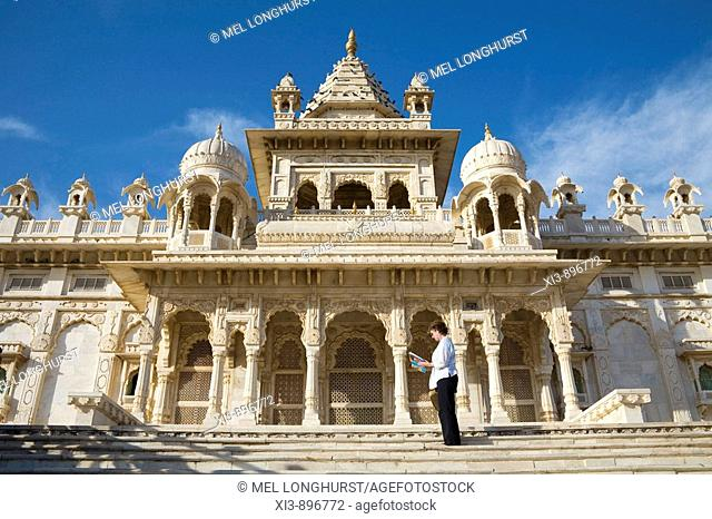 Tourist reading guidebook at Jaswant Thada Memorial, Jodhpur, Rajasthan, India