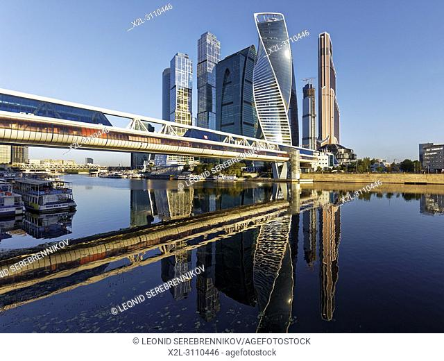 High rise buildings of Moscow International Business Centre (MIBC) and Bagration pedestrian bridge reflected in Moskva River. Moscow, Russia