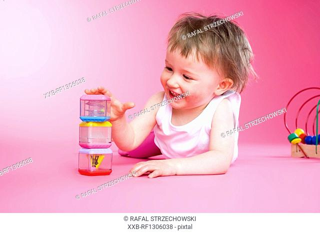 samll girl paying with toys