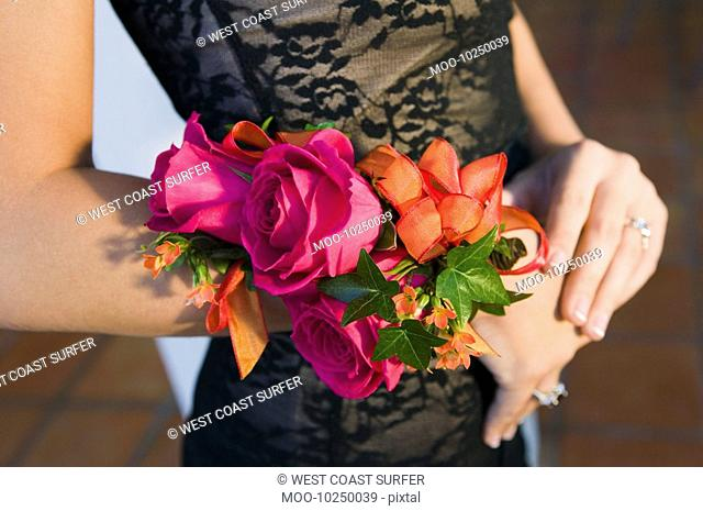 Teenage girl wearing corsage close-up of flowers