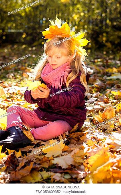beautiful little cute kid in autumn park