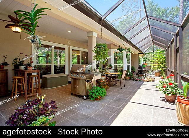 New Home Mid Range Luxury Patio Covered Exterior Outdoors Daytime Bright Sunny Warm Day Furniture Design