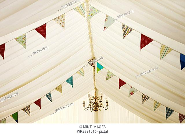 Interior view of a wedding marquee decorated with bunting