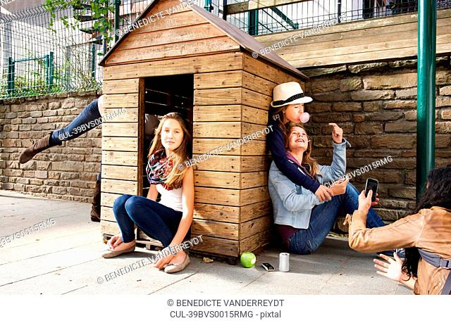 Teenagers playing in playhouse