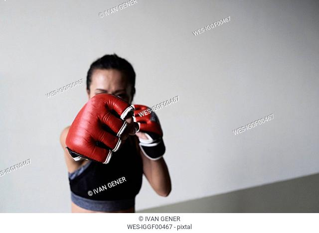 Boxing glove of a female boxer exercising