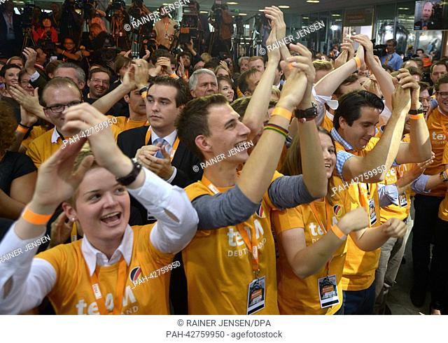 Supporters of the Christian Democratic Union (CDU) react to the results of the 2013 German federal elections at CDU party headquarters in Berlin, Germany