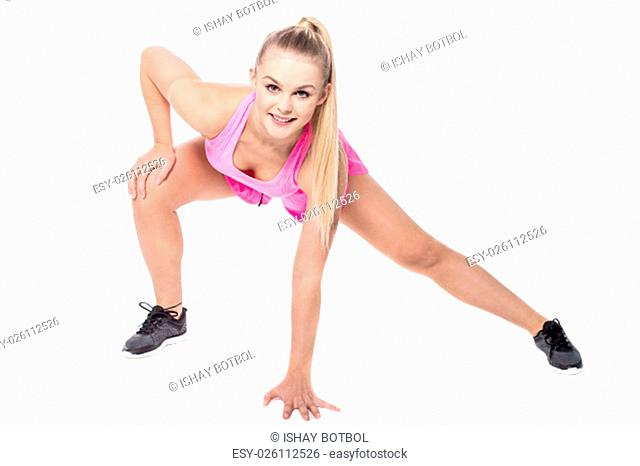 Pretty woman doing forward bend with side stretch