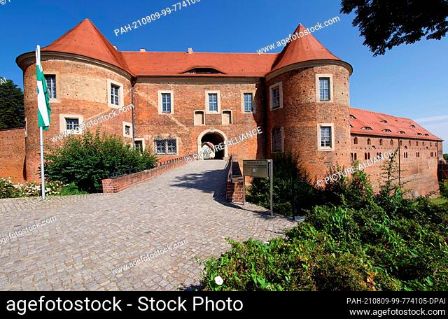 26 July 2021, Brandenburg, Bad Belzig: The cobbled stairway of Eisenhardt Castle. The well-preserved castle complex on the outskirts of the town is a landmark...