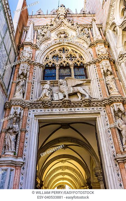 Saint Mark's Lion Primary Entrance Porta della Carte Palazzo Ducale Doge's Palace Venice Italy. Doge's Palace was the residence of the Venetian ruler from 1200s...