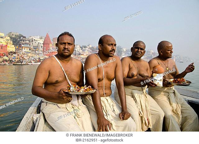 Remains of the cremation of a family member getting offered to the holy river Ganges, Varanasi, Uttar Pradesh, India, Asia