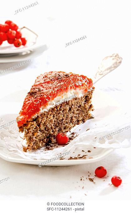 A slice of spice cake with rowanberry glaze