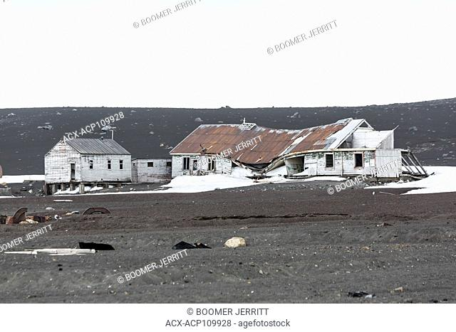 Abandoned buildings slowly give in to the elements in the bleak and harsh environment on Deception Island, South Shetland Islands, Antarctic Peninsula