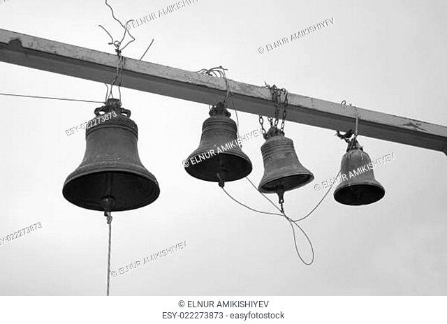 Four bells against a sky - black and white photo