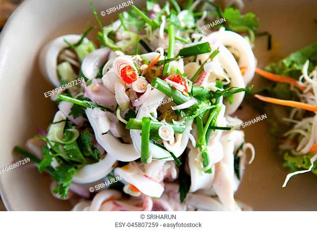 Spicy squid salad on the white plate
