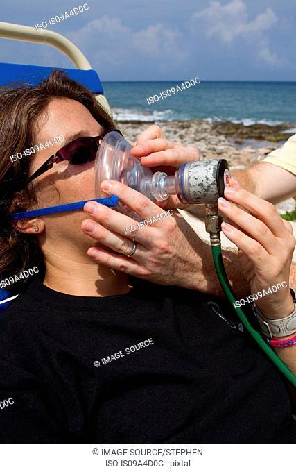 Scuba Diver breathes Oxygen