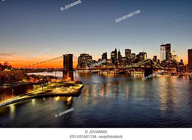 Wonderful lights of Brooklyn Bridge at winter sunset, New York City