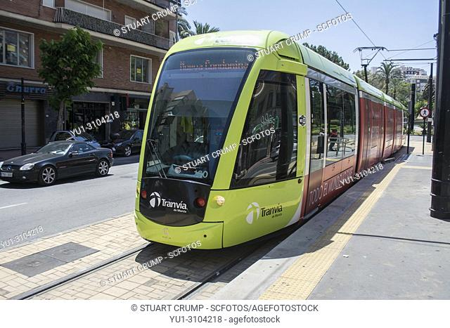 Tram arrives at the tram stop at the Plaza Circular in the Spanish City of Murcia