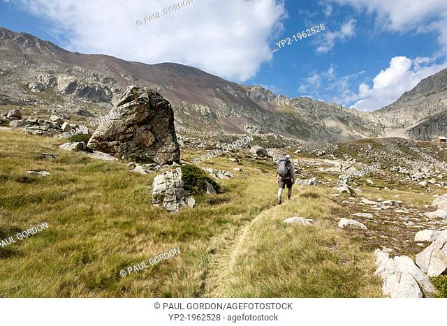 Man Hiking the GR 11 Footpath along the Vall d'Anglos in the Spanish Pyrenees - Huesca, Aragon, Spain