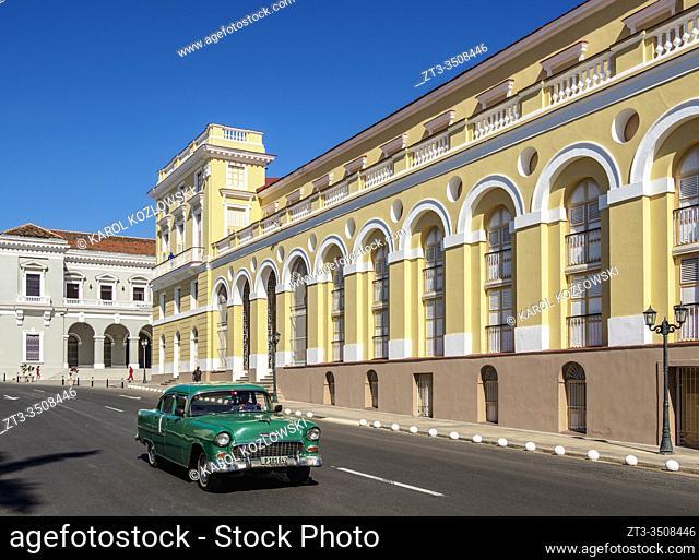 Vintage car passing by the Sauto Theater, Matanzas, Matanzas Province, Cuba