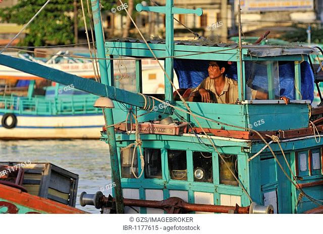 Fishermen on his boat on Phu Quoc, Vietnam, Asia