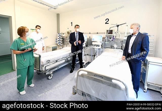 14 May 2020, Bavaria, Munich: Esther Kaaden (l-r), head of the nursing ward, Niklas Schneider, physician in charge of the ward, Markus Söder (CSU)